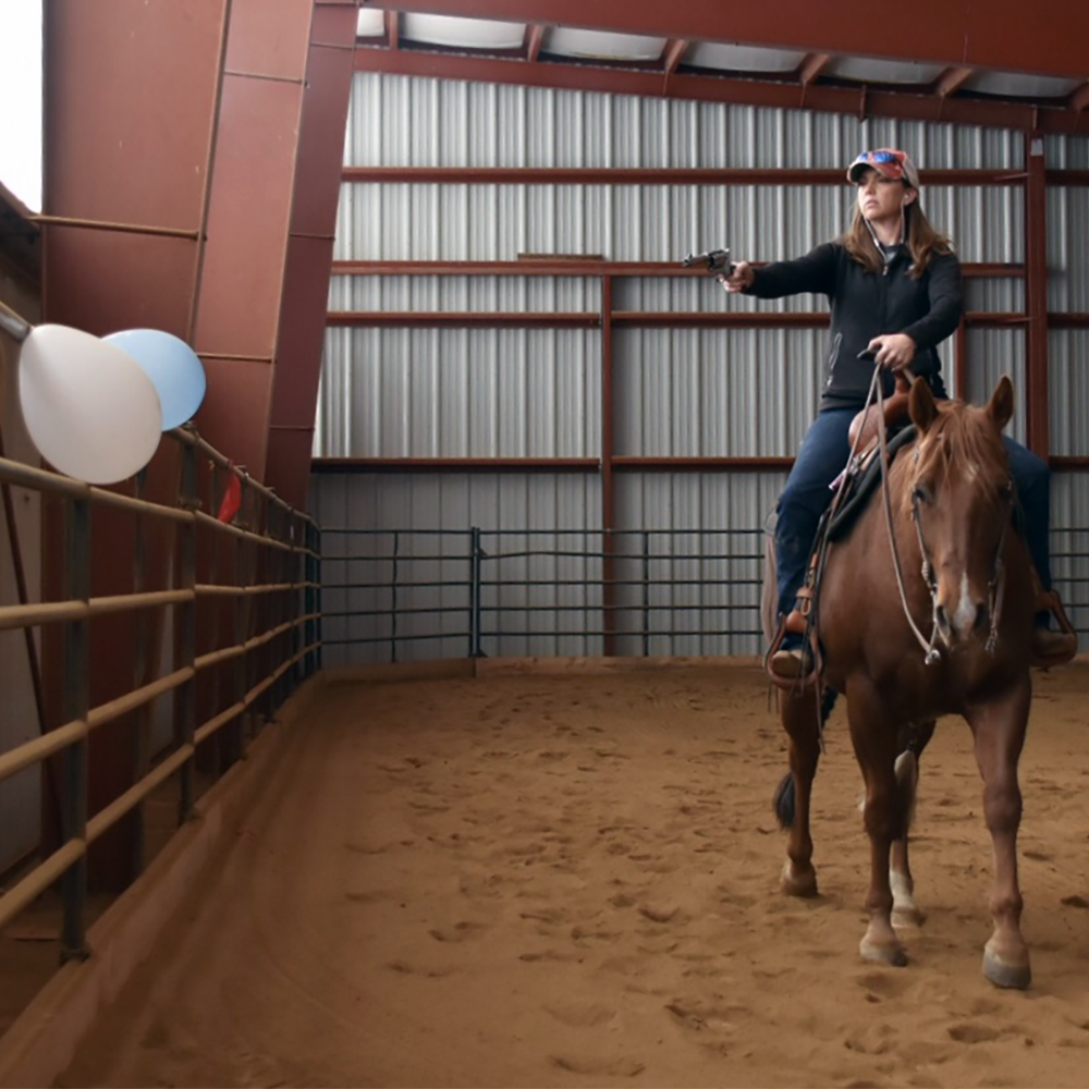 Melissa working with Eddie to learn mounted shooting.